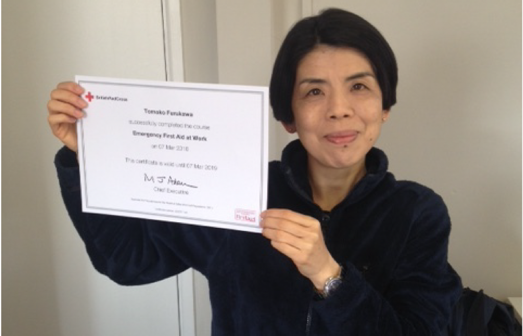Tomoko with First Aid Certificate