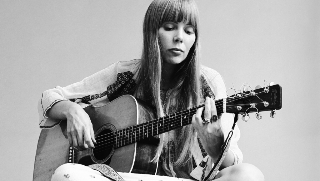 Joni Mitchell in the 70s playing the guitar